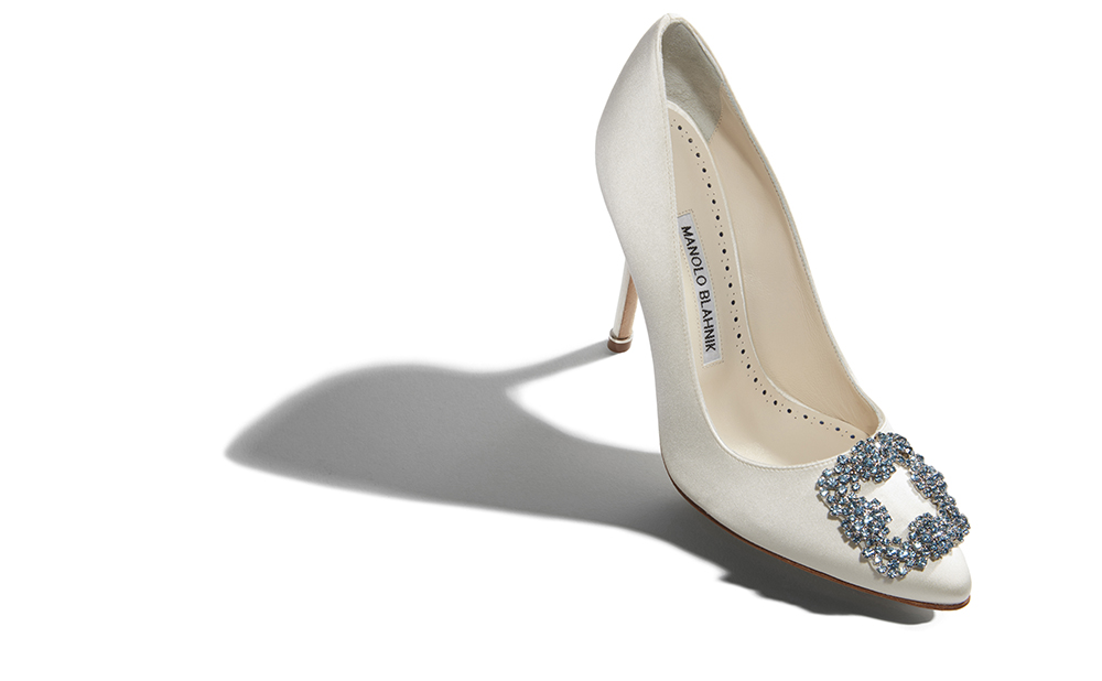 White shoe with a blue crystal buckle