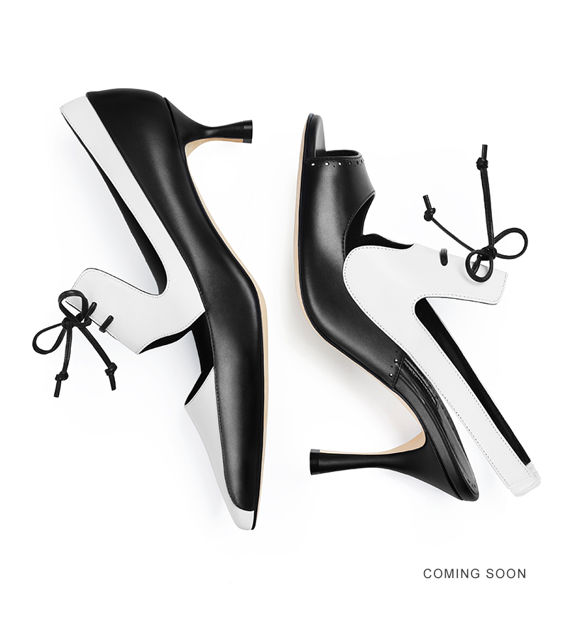 A black and white calf leather lace up pump