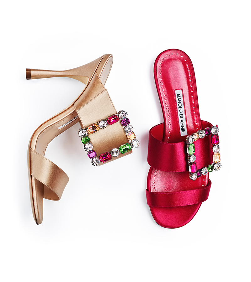 A champagne satin satin with a bright pink flat mule with colourful crystal buckles