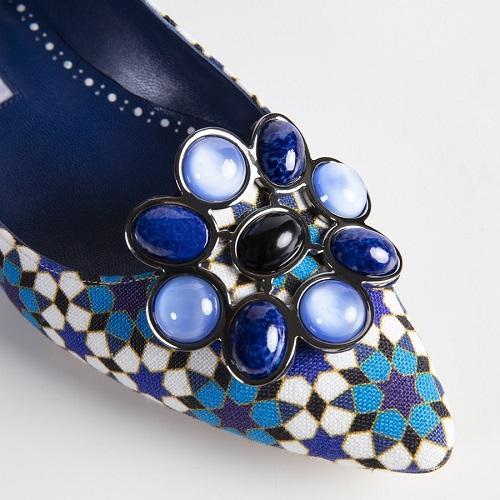 A blue geometric print shoe with enamel buckle