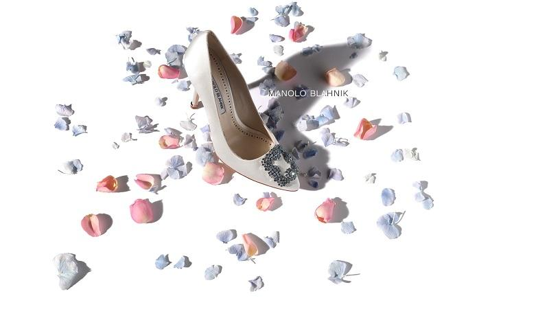 White shoe surrounded by pink and blue rose petals