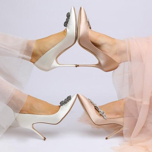 toe to toe wearing white satin and champagne satin pumps