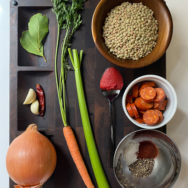 A chopping board full of ingredients for cooking