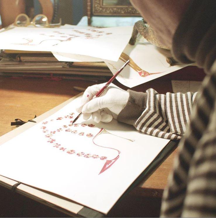 Manolo sketching at his desk