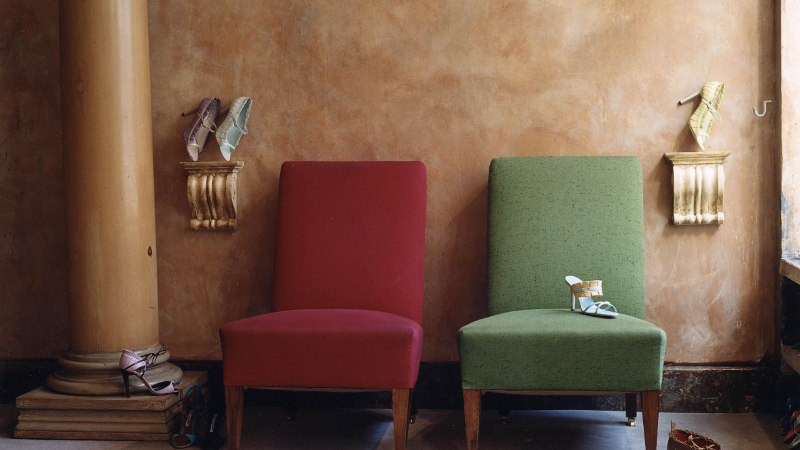 Inside the Old Church Street store. There are two chairs, one red, one green.