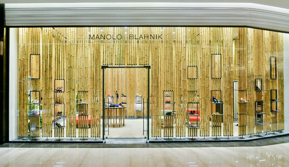 The Manolo Blahnik standalone store in Breeze NanShan, Taipei, Taiwan. The main window features strips of bamboo across.