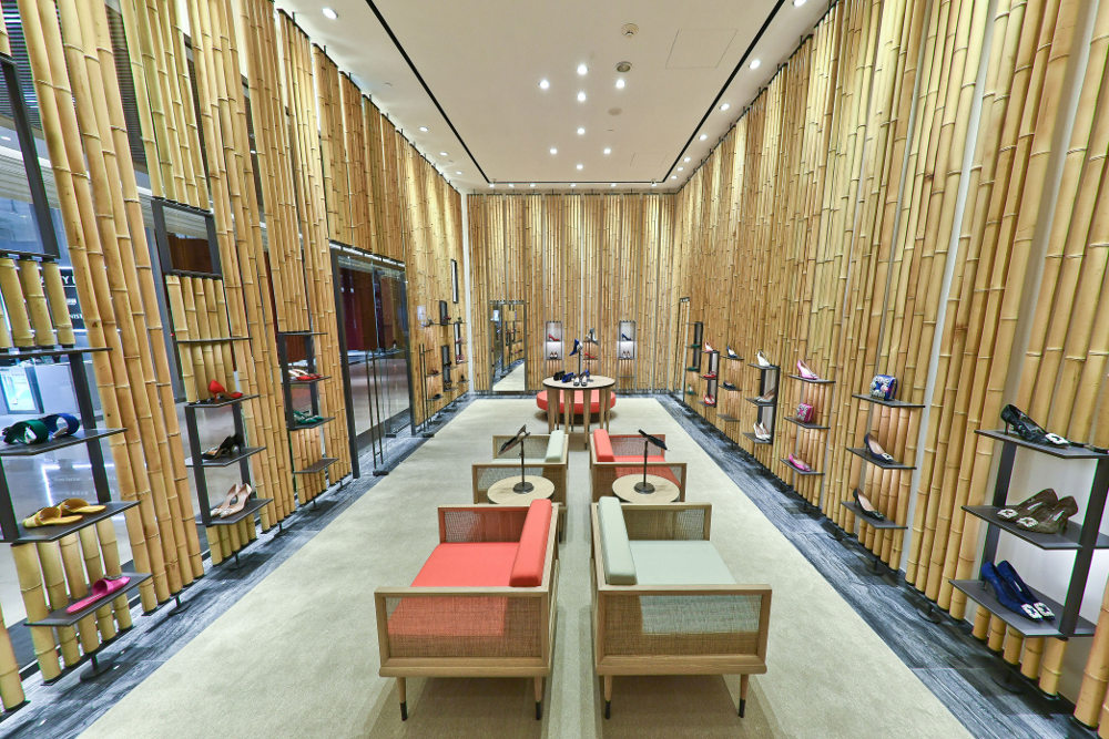 An internal view of the Breeze NanShan store. The walls are clad in bamboo cane with shelves for shoes inbetween.