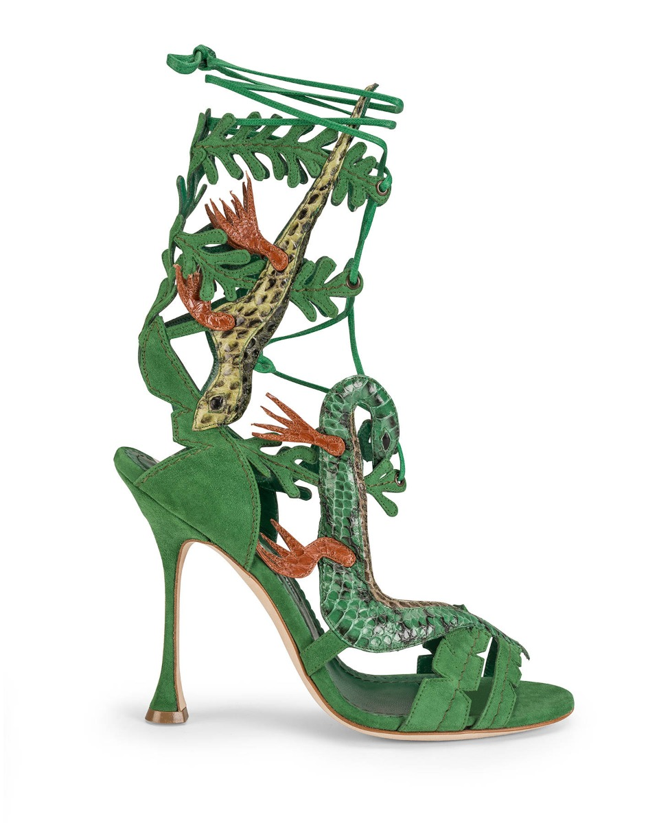 The Lagarta shoe, a green high heeled strappy sandal with appliquéd lizards and leaves.