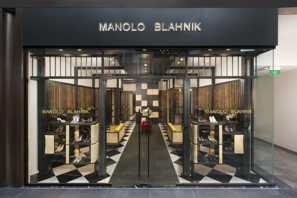 Outside the Marina Bay Sands, Singapore store. The outside of the shop is floor to ceiling glass, with Manolo Blahnik logo.