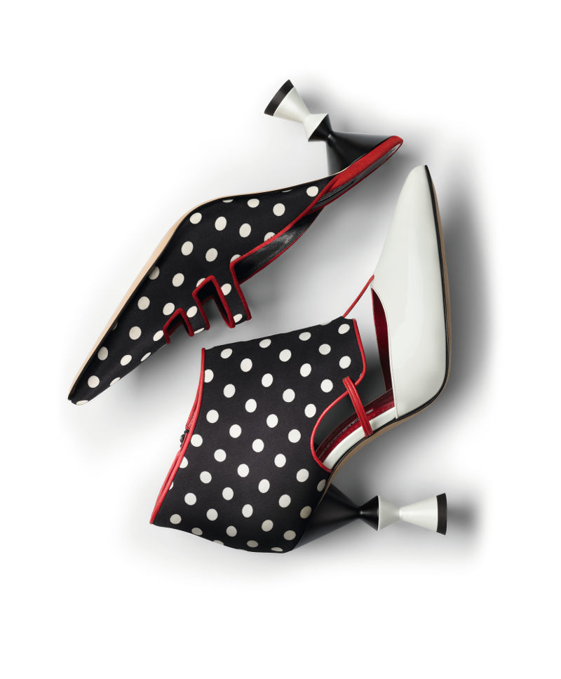Two black and white spotty shoes, one mule one ankle boot, inspired by Milanese entryways.