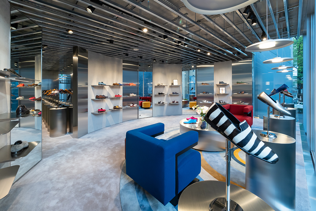 The first floor of the Omotesando, Tokyo store. Men's shoes are displayed on shelves.