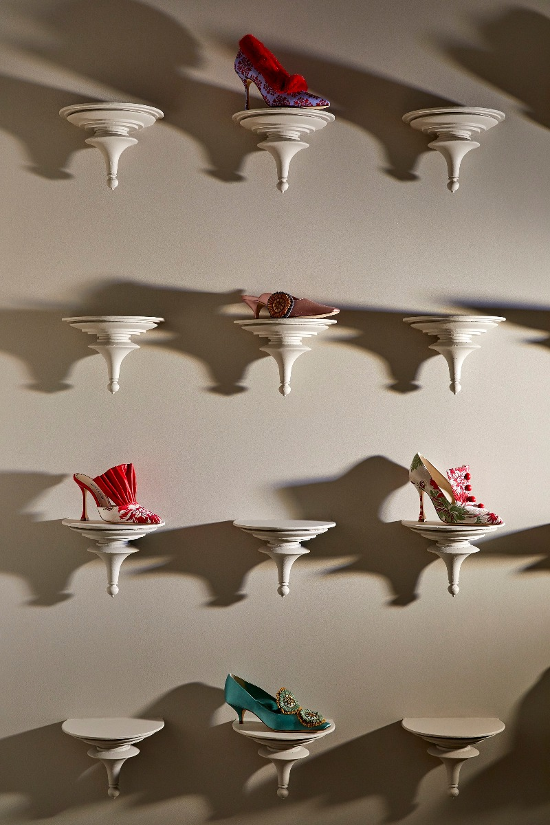 Shoes on individual conical shelves in the store.